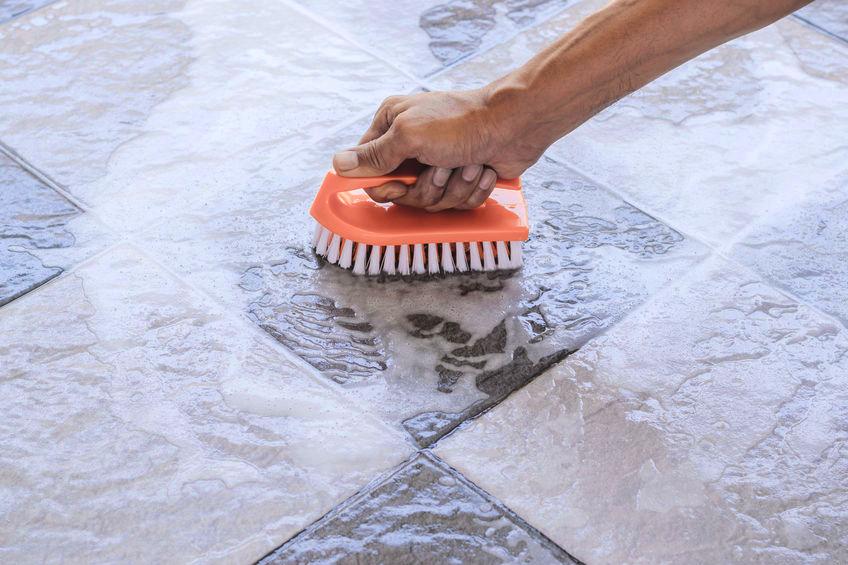 Man scrubbing tile floor